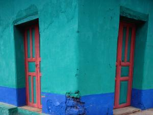 Brightly Painted Corner House in Chinique, Quiche, Guatemala by Jeffrey Becom
