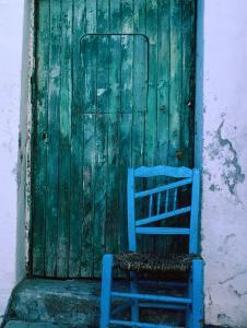 Chair in Front of a Green Door in the Village of Caceres, Caceres, Extremadura, Spain by Jeffrey Becom