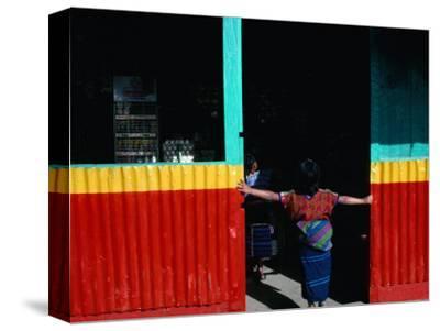 Girl Standing in Market Doorway, Santa Maria De Jesus, Guatemala