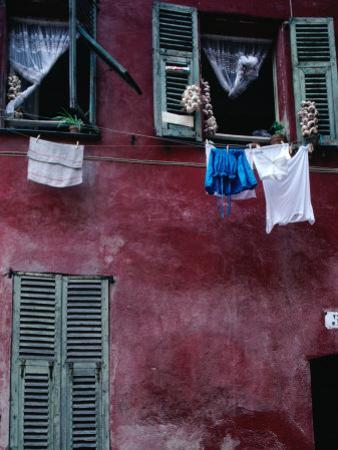 Laundry and Garlic Drying from Upstairs Window, Nice, Provence-Alpes-Cote d'Azur, France by Jeffrey Becom