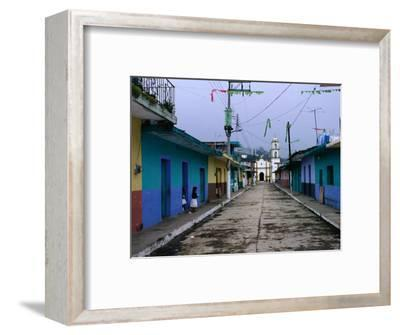 Painted Row of Houses with Distant Chapel in Acatlan, Veracruz, Mexico