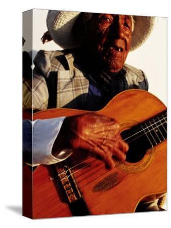 Portrait of Old Man Playing Guitar, Paracas, Peru