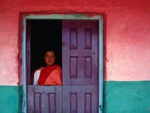 Young Maya Woman in Doorway of Home Zinacantan, Chiapas, Mexico by Jeffrey Becom