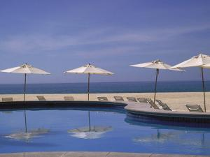 Pool and Umbrella, Cabo San Lucas, Mexico by Jennifer Broadus