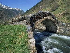 Ancient Stone Bridge over a River in the La Malana District in the Pyrenees in Andorra, Europe by Jeremy Bright
