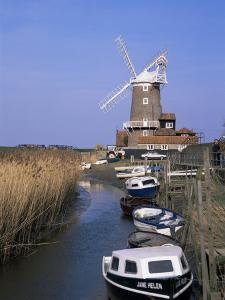 Boats on Waterway and Windmill, Cley Next the Sea, Norfolk, England, United Kingdom by Jeremy Bright