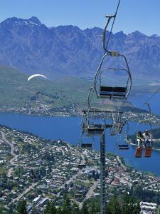 Chair Lift with Lake Wakatipu, the Remarkable Mountains and Queenstown, South Island, New Zealand by Jeremy Bright
