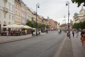 Cobbled Old Town Krakowskie Przedmiescie Street and street cafes, Warsaw, Poland, Europe by Jeremy Bright