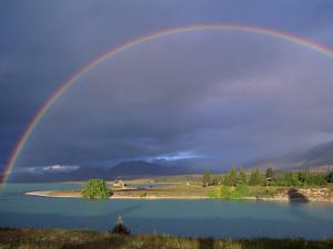 Rainbow over Lake Tekapo, Canterbury, South Island, New Zealand, Pacific by Jeremy Bright