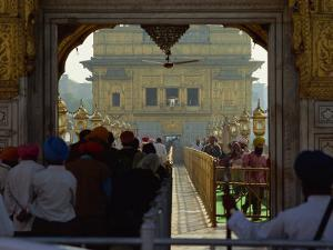Sikhs at the Entrance to the Golden Temple, Crossing Guru's Bridge, Amritsar, Punjab, India by Jeremy Bright