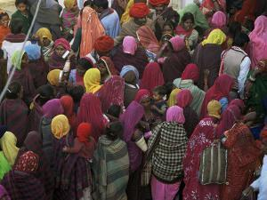 Women from Villages Crowd the Street at the Camel Fair, Pushkar, Rajasthan State, India by Jeremy Bright