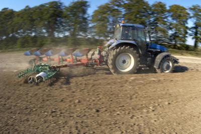 Tractor Ploughing a Field by Jeremy Walker