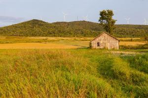 An Old Farm Building in a Field Next to the Mars Hill Wind Farm in Mars Hill, Maine by Jerry and Marcy Monkman