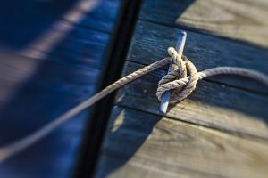 Rope Tied to a Dock in Pamet Harbor in Truro, Massachusetts. Cape Cod by Jerry and Marcy Monkman