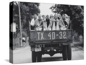 Farm Girls Riding in a Truck by Jerry Cooke