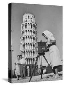 New England Couple Being Photographed by an Italian Woman in Front of the Leaning Tower of Pisa by Jerry Cooke