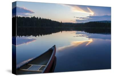 A Canoe on Little Berry Pond in Maine's Northern Forest. Sunset