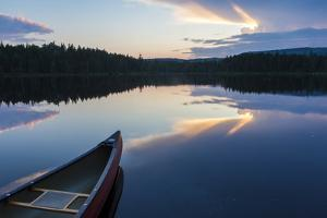 A Canoe on Little Berry Pond in Maine's Northern Forest. Sunset by Jerry & Marcy Monkman
