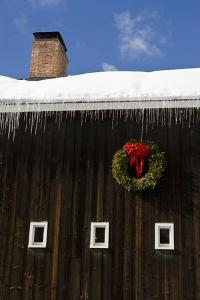 A christmas wreath on a barn in Grafton, Vermont. by Jerry & Marcy Monkman