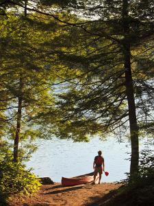A Man Next to His Canoe at Zack Woods Pond, Hyde Park, Vermont, Usa by Jerry & Marcy Monkman