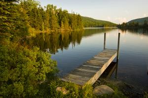 A Small Dock in Long Pond in New Hampshire's White Mountains by Jerry & Marcy Monkman