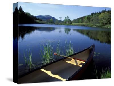 Canoe Resting on the Shore of Little Long Pond, Acadia National Park, Maine, USA