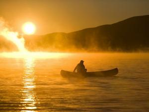Canoeing in Lily Bay at Sunrise, Moosehead Lake, Maine, USA by Jerry & Marcy Monkman