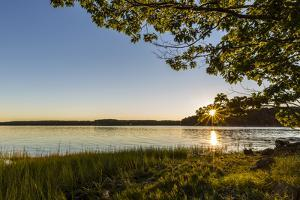 Dawn breaks over Great Bay at Adams Point in Durham, New Hampshire. by Jerry & Marcy Monkman