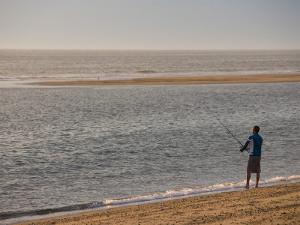 Early Morning Surfcasting on the Beach at Cape Cod National Seashore, Massachusetts, USA by Jerry & Marcy Monkman