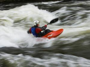 Kayaker Plays in a Hole in Tariffville Gorge, Farmington River in Tariffville, Connecticut, USA by Jerry & Marcy Monkman
