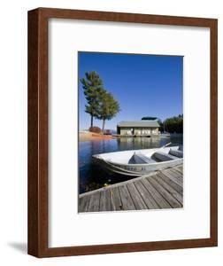 Skiff and boathouse at Oliver Lodge on Lake Winnipesauke, Meredith, New Hampshire, USA by Jerry & Marcy Monkman