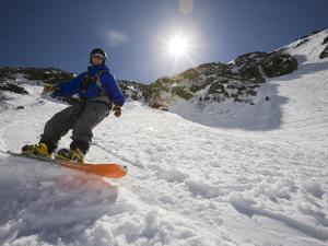 Snowboarder in Tuckerman Ravine, White Mountains National Forest, New Hampshire, USA by Jerry & Marcy Monkman