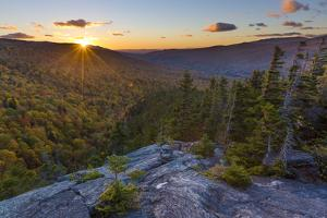 Sunset as seen from Dome Rock in New Hampshire's White Mountain National Forest. by Jerry & Marcy Monkman