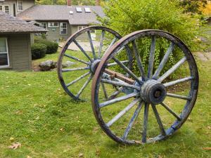 Wagon wheels at Oliver Lodge on Lake Winnipesauke, Meredith, New Hampshire, USA by Jerry & Marcy Monkman