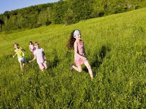 Young girls running in field, Sabins Pasture, Montpelier, Vermont, USA by Jerry & Marcy Monkman