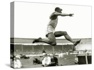 Jesse Owens in Action at the Long Jump During the Berlin Olympics, 1936