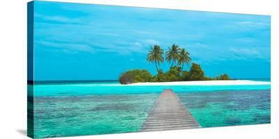 Jetty and Maldivian island-Pangea Images-Stretched Canvas Print