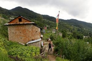 A Man Walks Through the Small Village of Tarebir, About an Hour Walk Up from Kathmandu by Jill Schneider