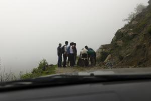 Men Remove Rocks from a Landslide During Monsoon Season by Jill Schneider