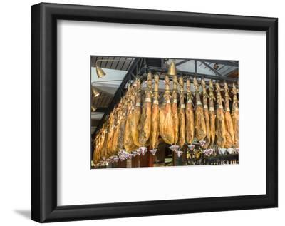 Spain, Barcelona, Iberico Ham Hanging in Store