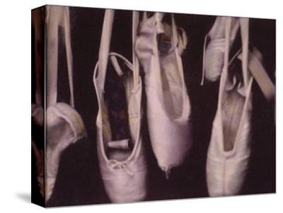 Worn Ballet Shoes Hanging in a Window
