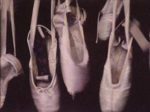 Worn Ballet Shoes Hanging in a Window by Jim Kelly