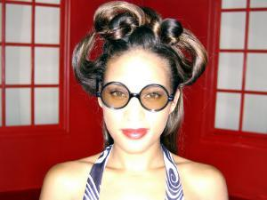 African-American Female with Funky Hair and Glasses by Jim McGuire