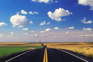 A Deserted Asphalt Road and Picturesque Landscape by Jim Reed