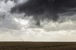A Long, Snake-Like, Tornado Spins across Cropland by Jim Reed