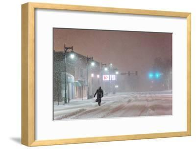 A Man Trudges Through Deep Snow on His Way to Work During a Predawn Snowstorm