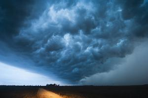 A Picturesque Supercell Thunderstorm at Twilight by Jim Reed