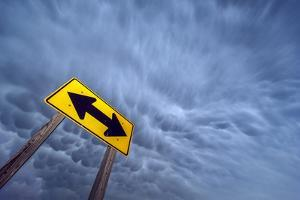 A Severe Thunderstorm with Mammatus Clouds Passes over a Yellow Double Arrow Road Sign by Jim Reed