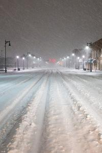 A Snowstorm Strikes a City in the Middle of the Night by Jim Reed