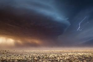 A Supercell Thunderstorm Produces Cloud-To-Cloud Lightning by Jim Reed